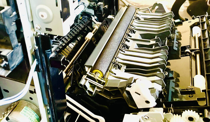 our team repairing printers | printer spare parts